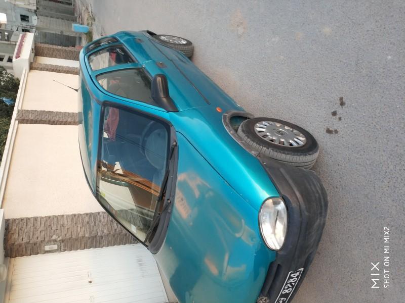 Opel corsa swing 4 cylindre lazemha tola ou dhina